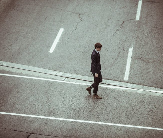 businessman-crossing-disappointed-201-653x550